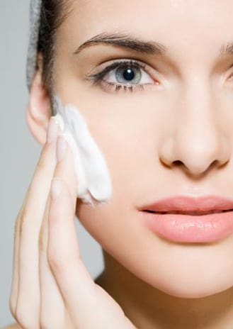 Woman-applying-skincare